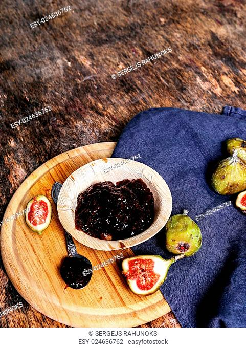 Green fig on the wooden table