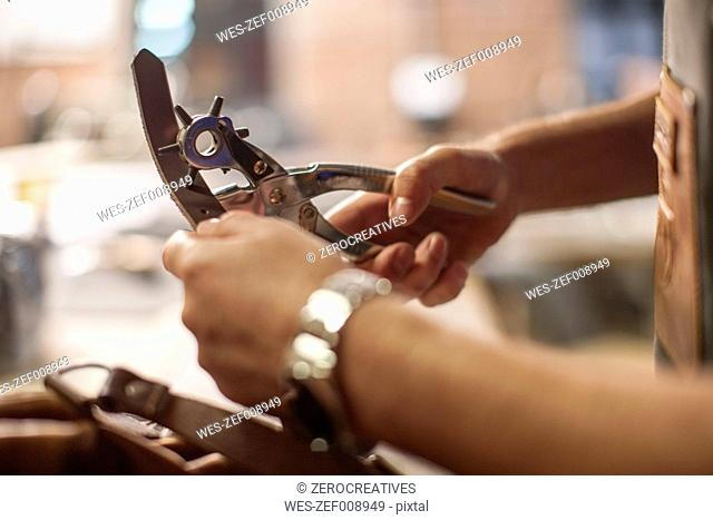 Close-up of man working in leather workshop