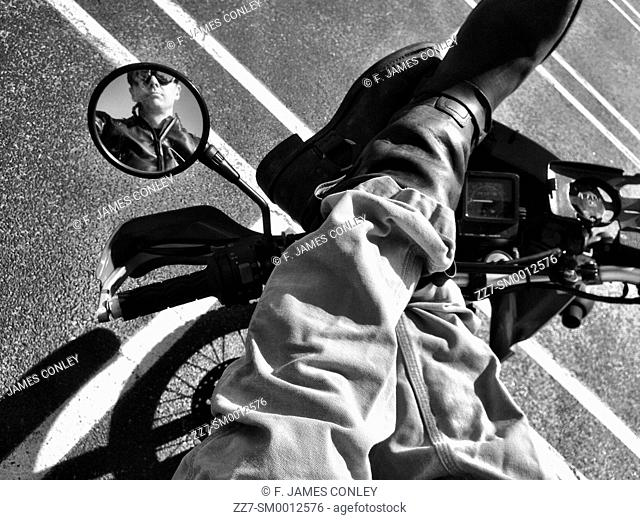 A biker reflected in a mirror