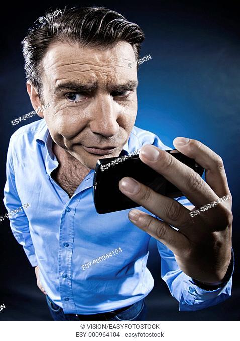 caucasian man portrait cellphone doubtful isolated studio on black background