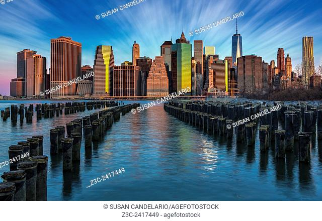 A New York City Day Begins - The sun has just begun to rise painting the New York City lower Manhattan skyline with it warm golden, pink and pastels hues
