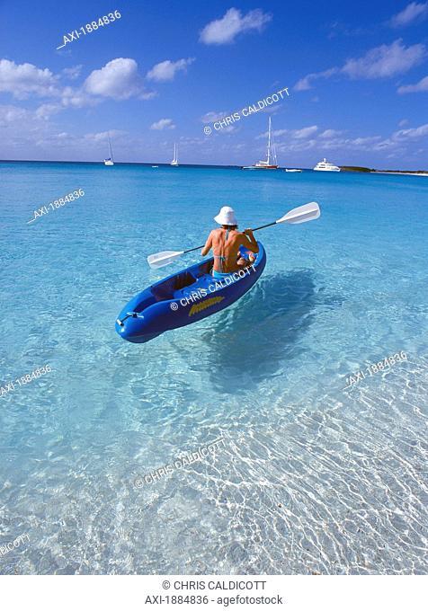 Female Tourist In Kayak On Ocean