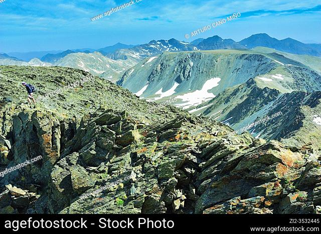 View from the summit of Peak Carlit (2912 mts.). The Catalan Pyrenees Regional Natural Park in the French Pyrenees. Angoustrine-Villeneuve-des-Escaldes town