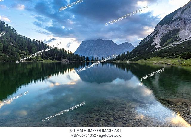 Austria, Tyrol, Mieminger Chain, Coburger Hütte, Seebensee and Zugspitze in the early morning