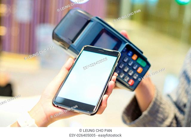Woman using cellphone to checkout