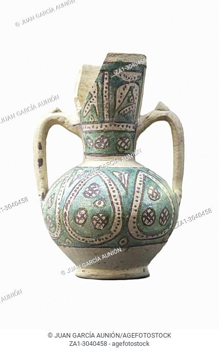 Glazed Jar with green geometrical decoration from Middle Ages muslims domination. Mengibar, at Jaen Museum. Jaen, Andalusia, Spain