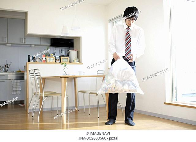 Businessman With Bin Bag Walking