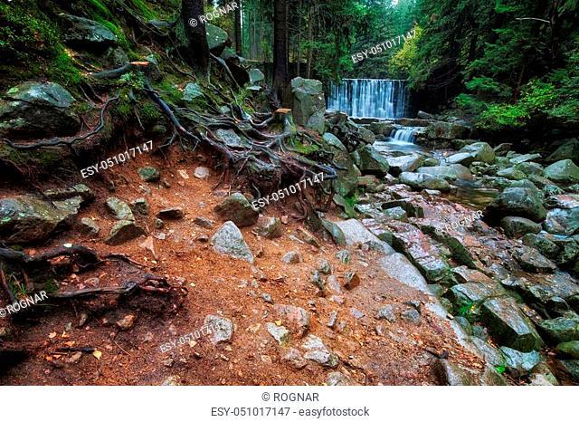 Mountain river with waterfall in Karkonosze National Park (Polish: Karkonoski Park Narodowy), Sudetes Mountains, Karpacz, Poland