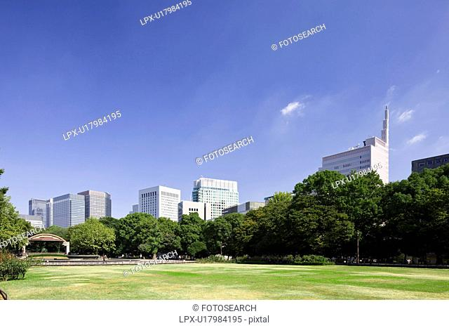 Hibiya park and skyline of Marunouchi, Chiyoda Ward, Tokyo Prefecture, Honshu, Japan