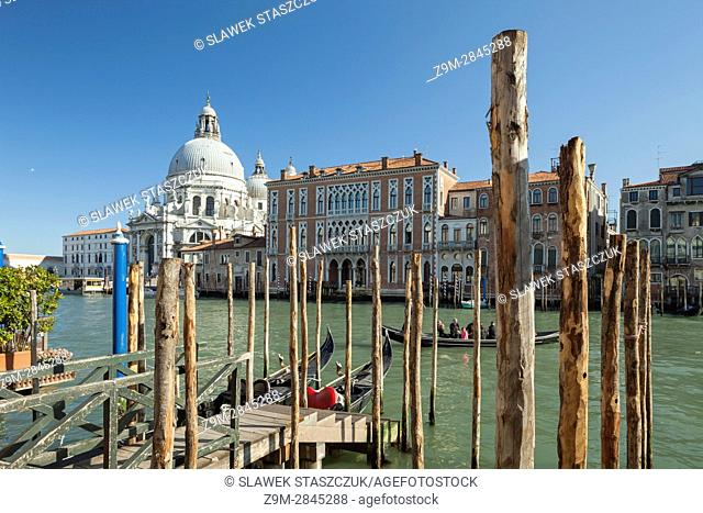 Afternoon on Grand canal in Venice, Italy. Iconic dome of the church of Santa Maria della Salute in the distance