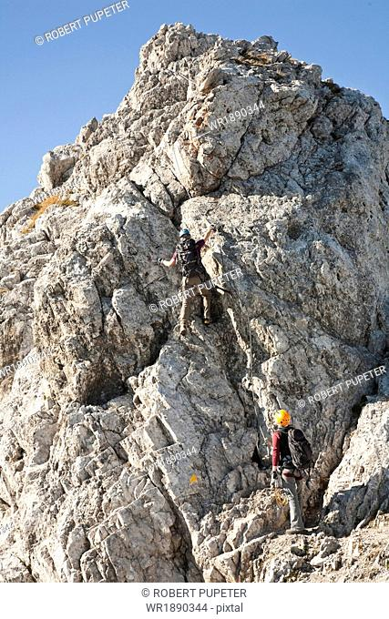 Two female alpinists rock climbing, Innsbruck route, Tyrol, Austria