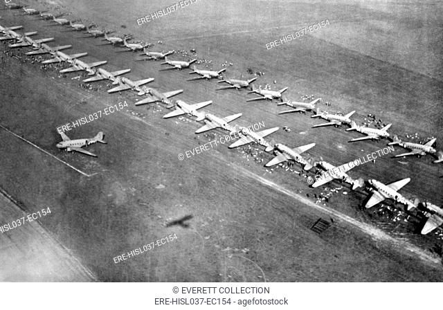 Long lines of C-47 transports loaded with paratroopers at an English airfield, Sept. 17, 1944. Operation Market Garden would drop 34
