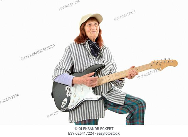 Funny elderly lady plays passionate electric guitar