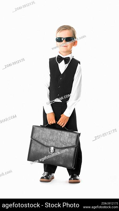 Boy holding a briefcase isolated on white background