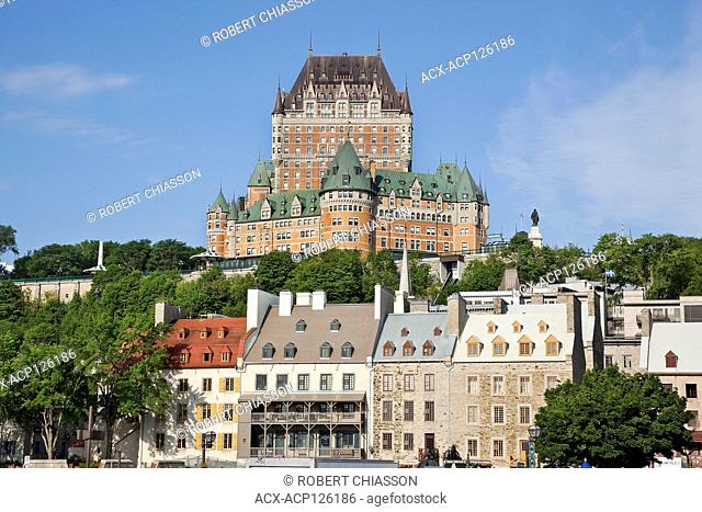Row of 18th century buildings at the base of Cap Diamant (Cape Diamond) upon which sits the Chateau Frontenac, Old Quebec City, Province of Quebec, Canada