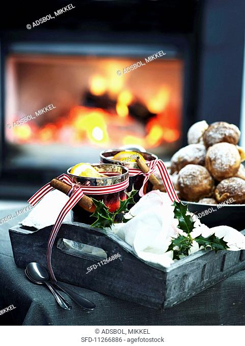 Mulled wine and Christmas biscuits in front of a fire place