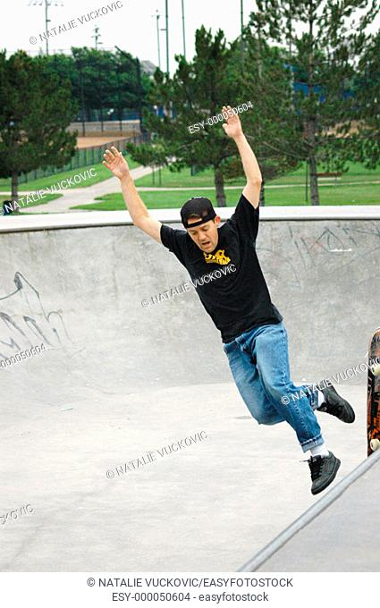 Skateboarder taking a fall
