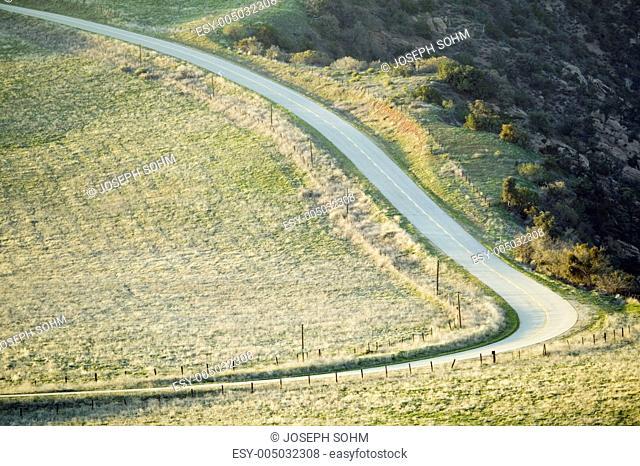 Rural road winding through fields and hills near Pine Mountain Club, Kern County, California