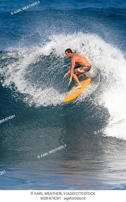 Man surfing in Maui, Hawaii