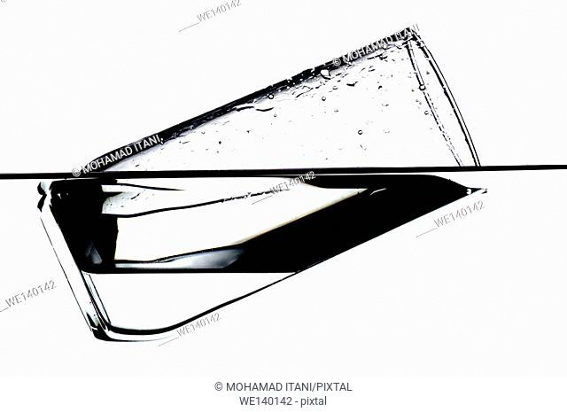 Horizontal Shot of a glass floating on water