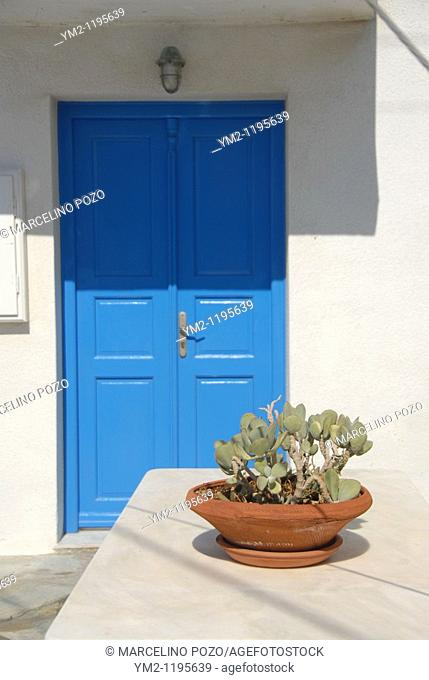 Mikonos blue door house with pot at the entrance