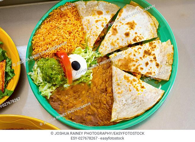 An authentic quesadilla at Mexican restaurant with rice and beans