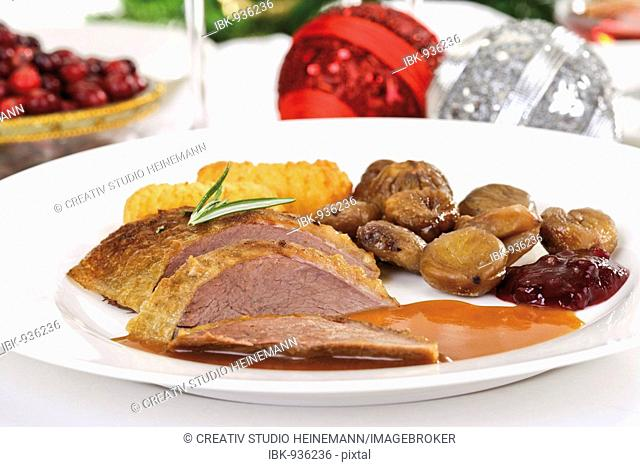 Roast goose-breast with gravy, potato croquettes, sweet chestnuts