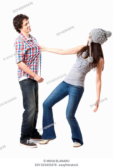 Lovely young couple having fun in studio