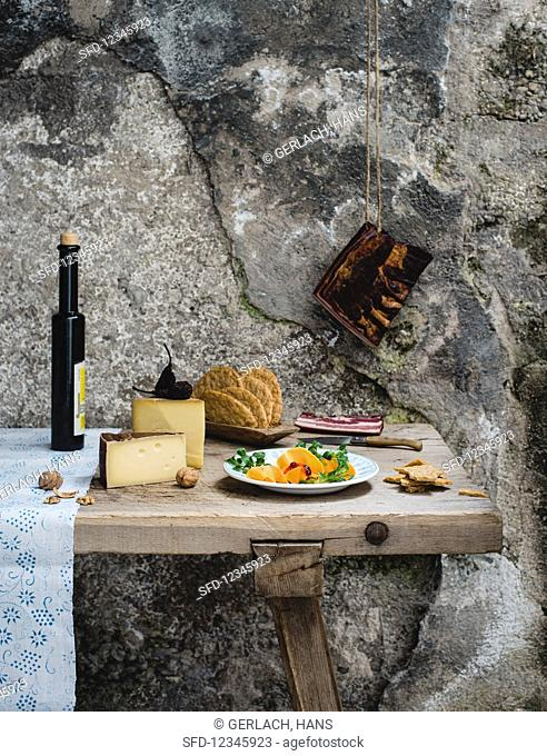 A rustic still life with ingredients for Alpine cuisine