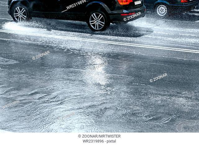 cars going through flood road