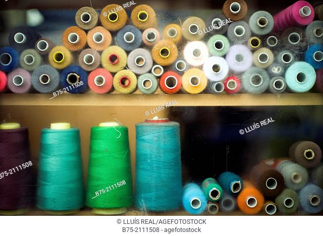 a lot of bobbins of sewing threads in a warehouse in London, England, UK, Europe