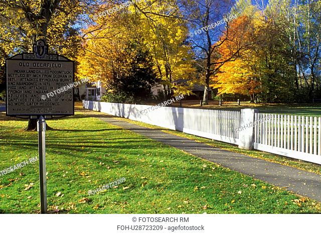 Deerfield, Massachusetts, MA, The Berkshires, White fence along the sidewalk and Old Deerfield sign in Historic Deerfield in the autumn