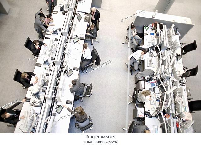 High angle view of business people at stock market