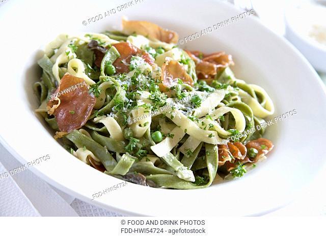 Tagliatelle pasta with cream, Parma Ham, garlic, mushrooms, peas and Parmesan