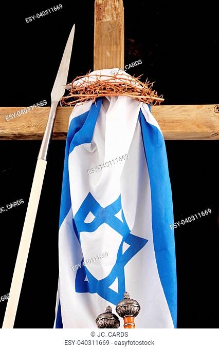 A cross with a israel flag, crown of thorns and Roman armor on a black background