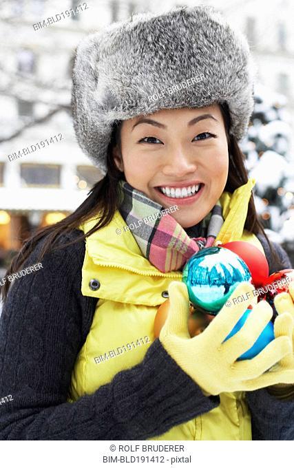 Korean woman carrying Christmas ornaments