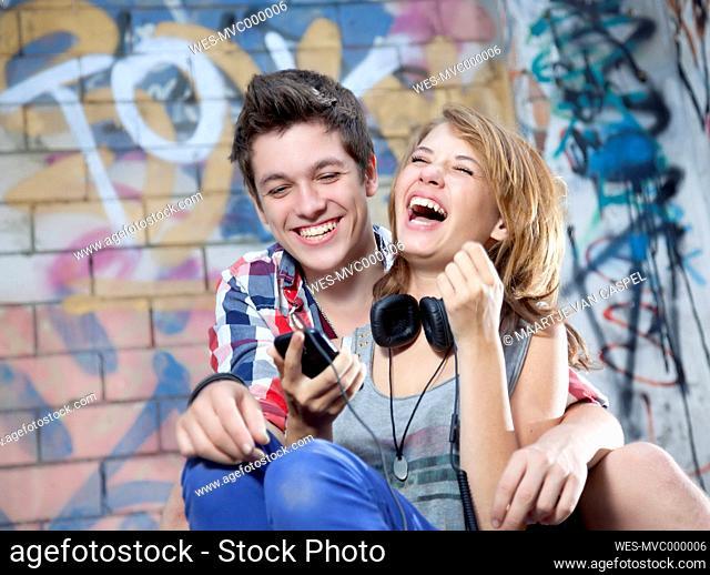 Germany, Berlin, Teenage couple laughing