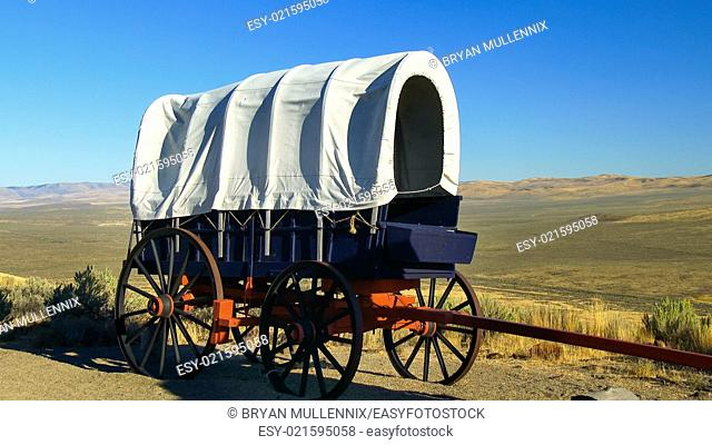 A covered wagon along the Oregon Trail with the Oregon prairie in background