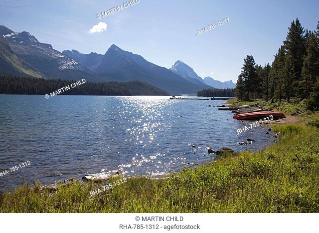 Morning light on Maligne Lake with canoes on shoreline, Jasper National Park, UNESCO World Heritage Site, British Columbia, Rocky Mountains, Canada