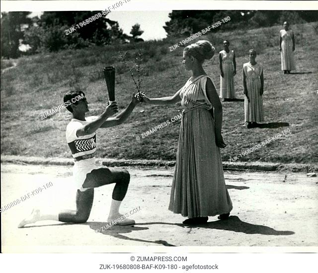 Aug. 08, 1968 - Lighting the Olympic Torch at Ancient Olympia. In the traditional ceremony at Ancient Olympia, Greece, the Olympic torch which will be carried...