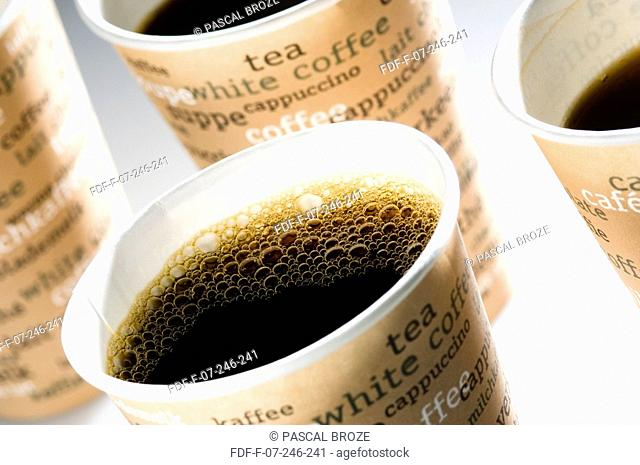 Close-up of four cups of black coffee