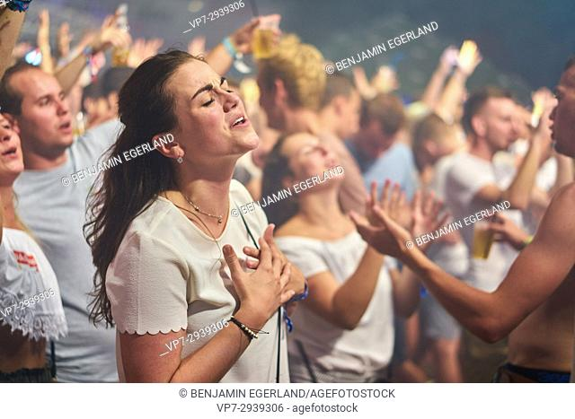 girls enjoying music festival Starbeach Dress In White Party on 31. July 2017 in Hersonissos, Crete, Greece
