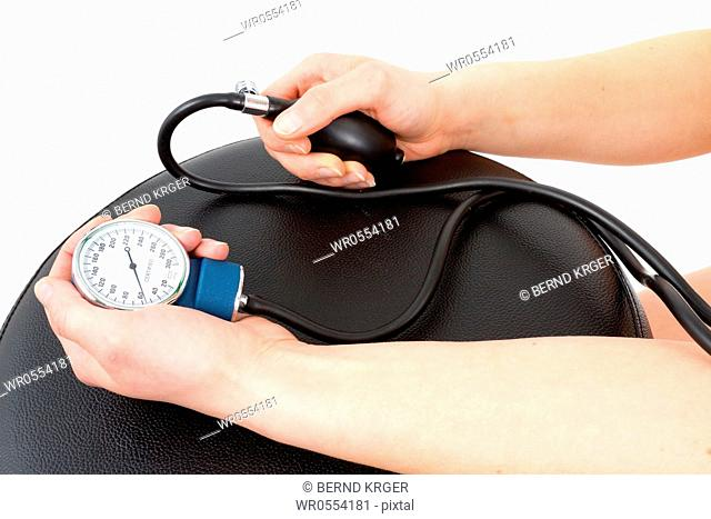 a young woman is taken blood pressure