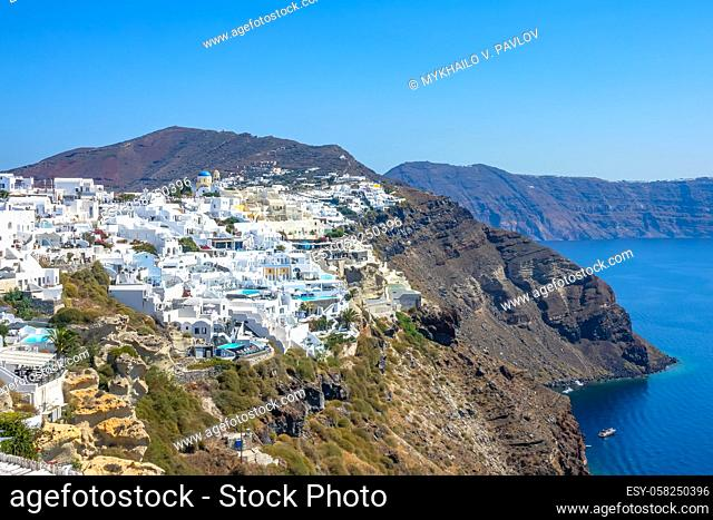 Greece. Colorful buildings on the Santorini caldera. Sunny summer day over the rocky coast