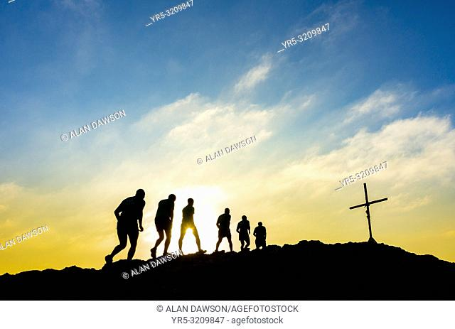 Las Palmas, Gran Canaria, Canary Islands, Spain. Soldiers from local military base out for morning run at sunrise on mountain summit near Las Palmas