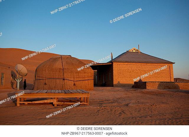 A family home, including yurt and satellite dish, in the Karakum Desert, Turkmenistan