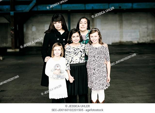 Portrait of mother with four daughters