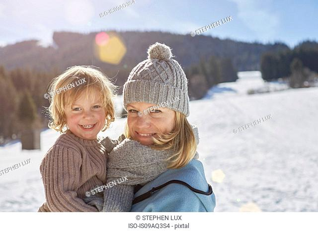 Mother and son enjoying day out in snow