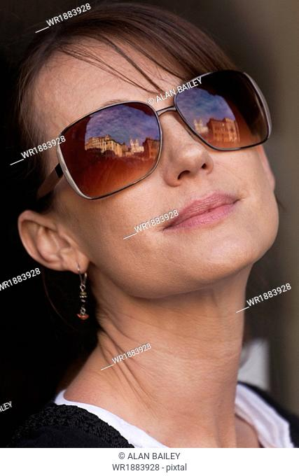 Italy, Rome, Spanish Steps, Portrait of woman wearing sunglasses