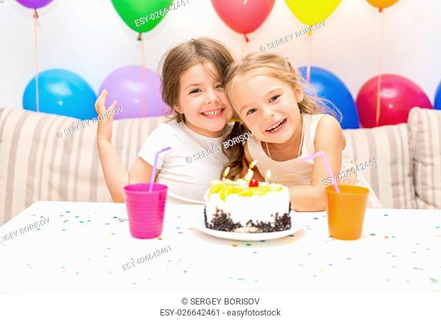 Birthday girl and her friend enjoying a birthday party
